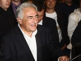 Dominique Strauss-Kahn Arrives in France to Cheers