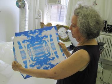 Artist Ultra Violet shows off a print in her West Chelsea studio, which will be open to the public this weekend.