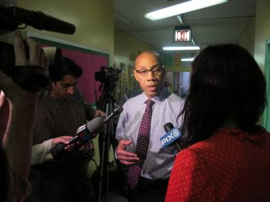 Dennis Walcott speaks to reporters at a teacher training event the day before the first day of school.
