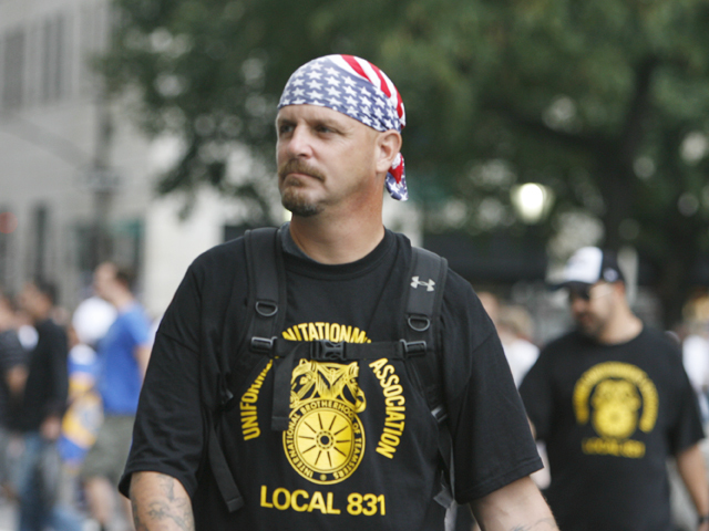 A member of the Teamsters wears patriotic head wear prior to the 10th Anniversary of the 9/11 terrorist attacks during the Labor Day Parade on Fifth Avenue on Sept. 10, 2011.