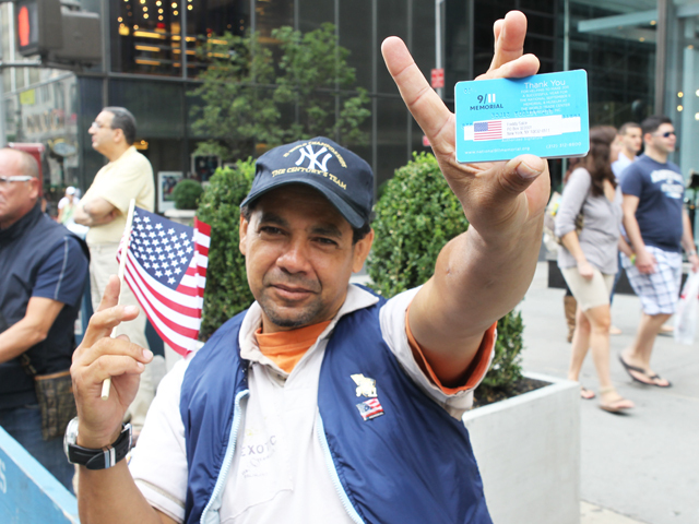 Freddy Salce, 40, a nurse said, holds an American flag at the Labor Day Parade on Fifth Avenue on Sept. 10, 2011.