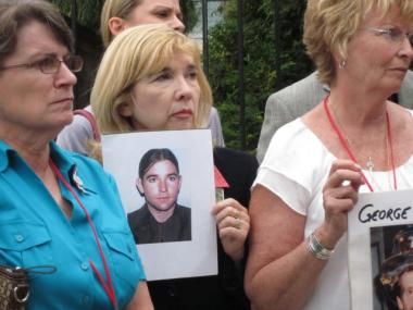 Sally Regenhard (center), clutches a photo of her son Christian at a memorial for unidentified remains of 9/11 victims on Sept. 10, 2011. To her right is Joyce Mercer (mother of firefighter Scott Kopytko) and to her left is Rosemary Cain (mother of firefighter George Cain).