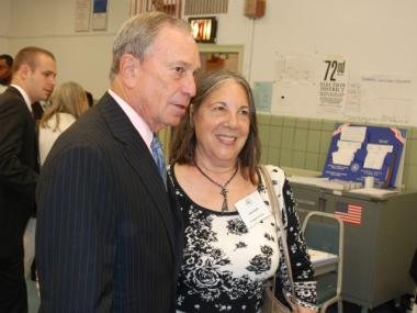 Mayor Michael Bloomberg poses for a photo with volunteer Gail Shemin.