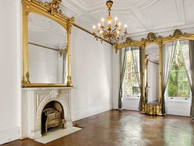 The 4,100-square-foot townhouse at 64 Perry St. boasts four floors, 10 rooms and six fireplaces.