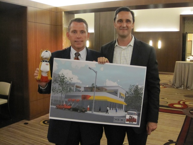 Boxers co-owners Rob Hynds and Bob Fluet stand with a mock-up of the their new Hell's Kitchen location.