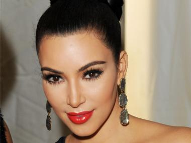 Kim Kardashian is one of many celebrities attending Fashion's Night Out on Sept. 6, 2012.
