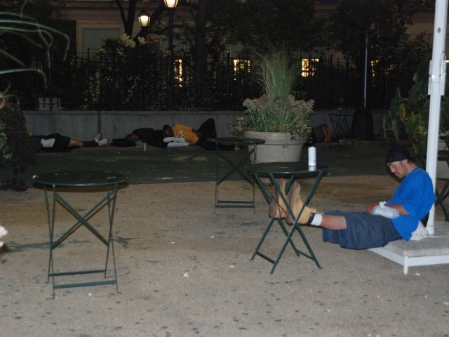 Men sleep in the plaza space directly in front of Macy's Herald Square, Tuesday, Sept. 13.