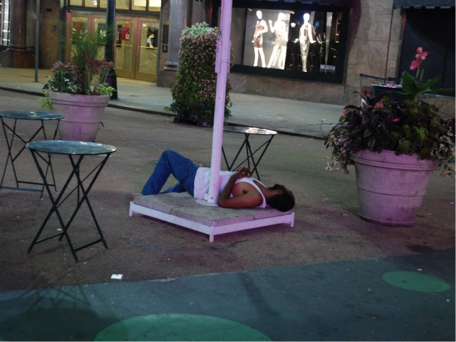 A man sleeps in the plaza space directly in front of Macy's Herald Square, Wed. Sept. 14.