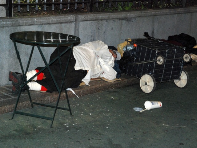 A man sleeps in the plaza space directly in front of Macy's Herald Square, Wed., Sept. 14.