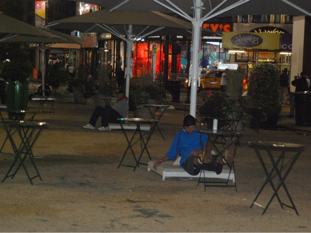 A man sleeps in the plaza space directly in front of Macy's Herald Square, Tues., Sept. 13.