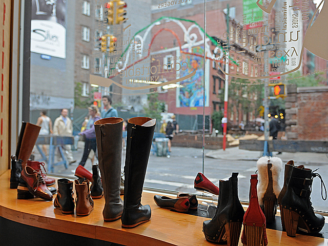 A boutique shoe store at the corner of Prince and Mulberry streets looks over the northern end of the festival on Thurs., Sept. 15, 2011.