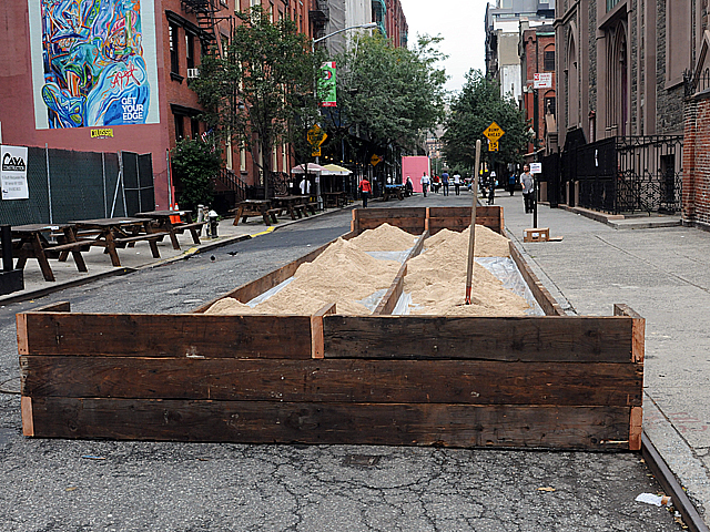 Festival organizers set up bocce ball courts on Mulberry Street just north of Prince Street on Thurs., Sept. 15, 2011.