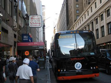 A BoltBus parked on West 33rd Street at Seventh Avenue.