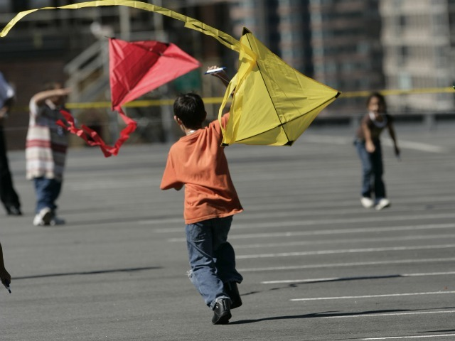 Children fly colorful kites at the annual event last year.