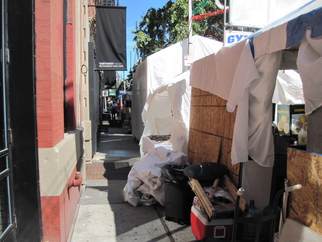 Sidewalks in front of shops on Mulberry Street next to the San Gennaro festival.