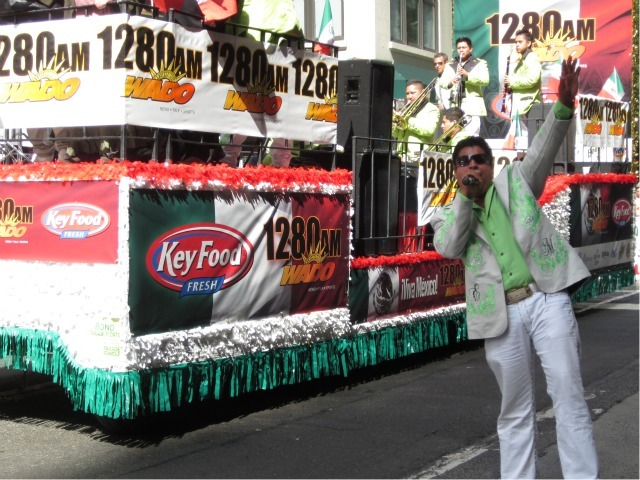 Eddie Mundez livens up the crowd as his band, called Banda Agave, passes behind on the float for the Mexican Independence Day Parade on Madison Avenue on Sept. 18, 2011.
