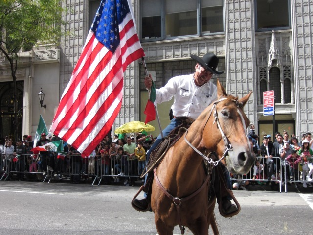 A cowboy on horseback with an American flag at the Mexican Independence Day Parade on Madison Avenue on Sept. 18, 2011.