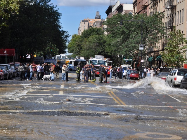 Pedestrians watched in amazement as water gushed onto Central Park West.