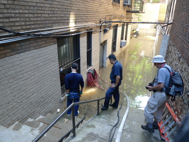 The rear courtyard of 467 Central Park West was flooded after a water main break near West 106th Street.