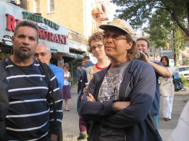 Inwood resident Donna Deming, 43, challenged Fernando Mateo to defend Gov. Rick Perry's stance on social welfare programs following a campaign fundraiser in the neighborhood on Sept. 19, 2011.