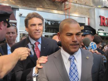Presidential Candidate Gov. Rick Perry clutched Inwood political figure Fernando Mateo as he exited a fundraiser in the neighborhood on Sept. 19, 2011.