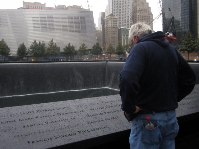First responders looked at names on the 9/11 Memorial Sept. 20, 2011.