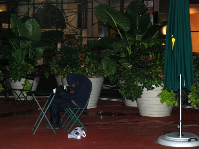 A man sleeps on Broadway's pedestrian plazas in the early morning hours of Tues., Sept. 20.