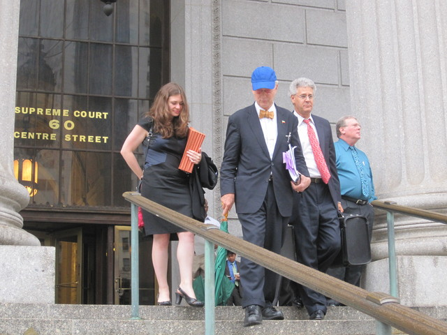 O. Aldon James leaves Manhattan Supreme Court on Tuesday, Sept. 20 with his lawyers.