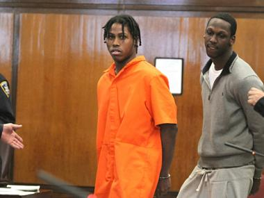 Alleged gang members Tyrone Gibbs (L) and Jaquan Layne (R) at their arraignments Feb. 16, 2011.