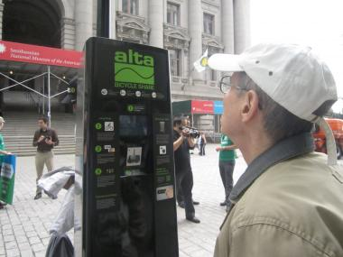 A man looked at the Alta Bicycle Share kiosk in Bowling Green, a preview of the 600 that will be in place next summer.