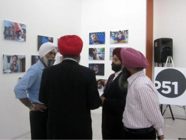 Four men including Rana Sodhi, second from right, who inspired the NYChildren photography exhibit, conversed at Park51's grand opening Sept. 21, 2011.
