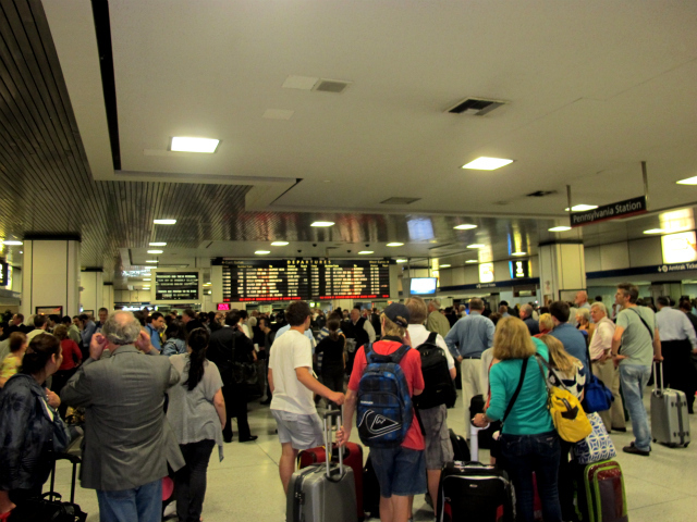 Customers pile up inside Penn Station after power outages on an Amtrak-run line stalled 4 NJ Transit trains, Sept. 22, 2011.
