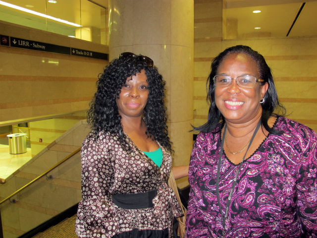 Mae Texiera (L) and her friend were Lucy Cudjoe-Jarvis, 54, (R) were trapped on a NJ Transit train inside a Hudson River tunnel for 2 1/2 hours because of a power outage, Sept. 22, 2011.