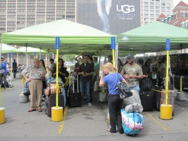 Passengers wait in the walled-in corral at the Megabus stop at 33rd Street and Ninth Avenue on Sept. 22, 2011.
