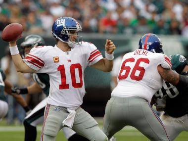 Giants quarterback Eli Manning throws against the Eagles in Philadelphia on Sept. 25, 2011.