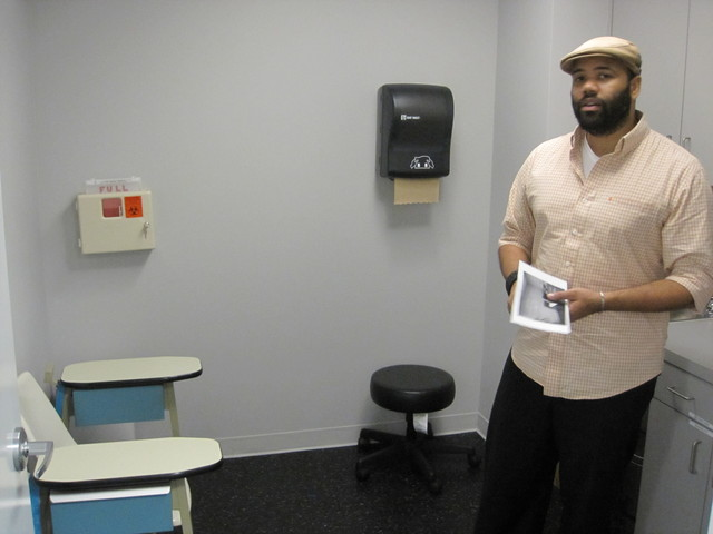 Kalyani Sanchez of GMHC shows off an HIV testing room on Tues., Sept. 27, 2011.