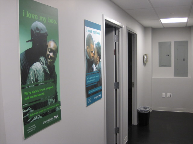 The center features many supportive posters, including these from GMHC's