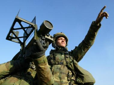 Soldiers aim a Stinger missile launcher during a military exercise on February 27, 2004 in Yeonchun, South Korea.