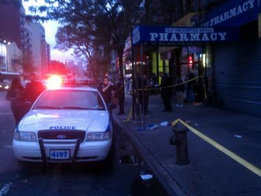 Three people were injured, one critically, during a shooting in Harlem on Sept. 28, 2011.