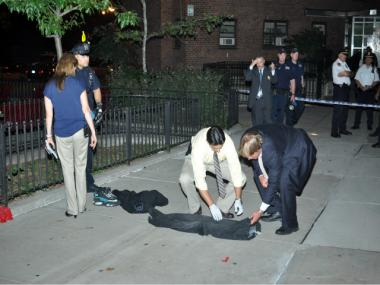 Investigators searched the scene of the shooting incident in East Harlem.