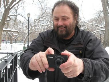 Bob Arihood, with his camera in Tompkins Square Park.