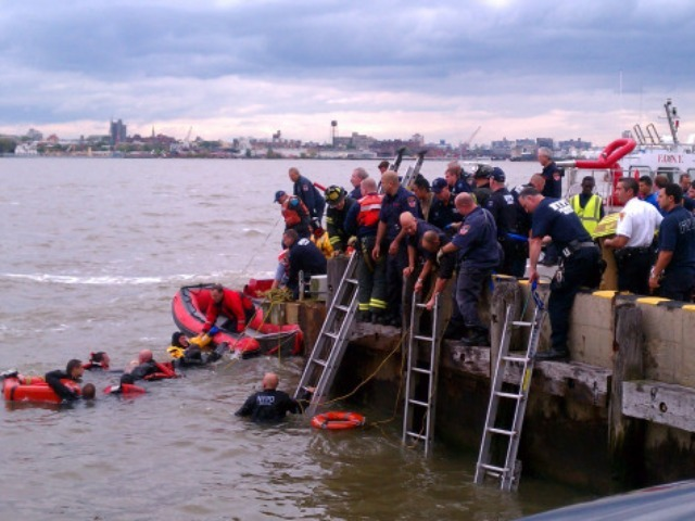 A rescue team was working to recover passengers from a helicopter crash in the East River, near East 34th Street heliport, on Tuesday Oct. 4, 2011