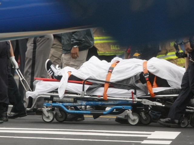 A victim is wheeled away after being pulled from the East River after a commercial helicopter crash on October 4, 2011 in New York City. A helicopter carrying at least three people crashed into the East River, killing one and seriously injuring two.