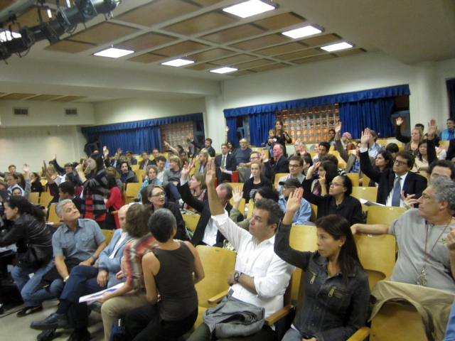 Downtown parents who have young children who have not yet started school raised their hands at a public hearing on the city's school rezoning proposal Oct. 4, 2011.