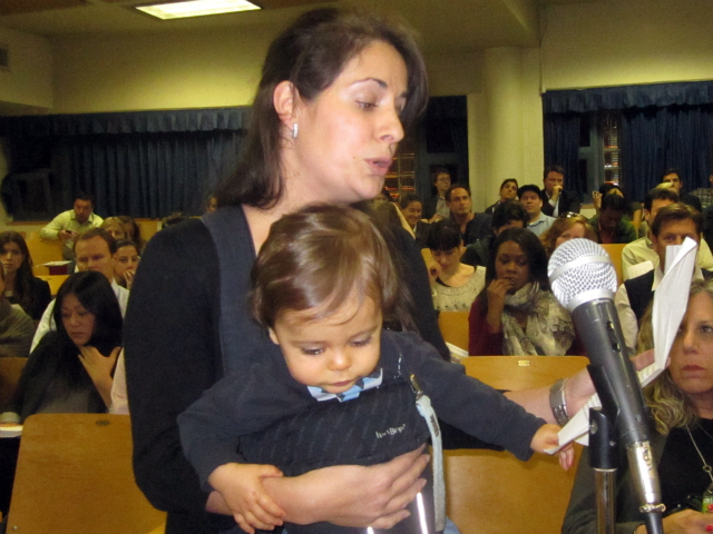 Wendy Driscoll, a North TriBeCa resident holding her 11-month-old son Alex, opposes the city's school rezoning plan.