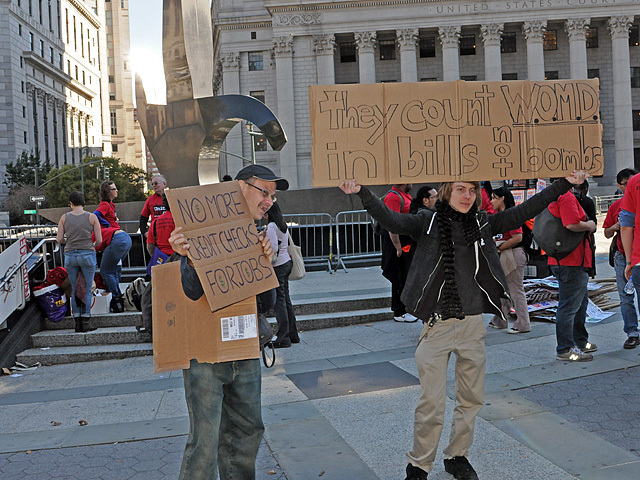 Protesters hold up signs at Foley Square ahead of an Occupy Wall Street rally there on Oct. 5, 2011.