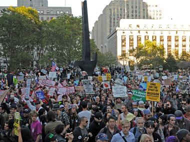 Protesters listen to speakers during the rally Oct. 5, 2011. A big day of action is planned for Nov. 17.