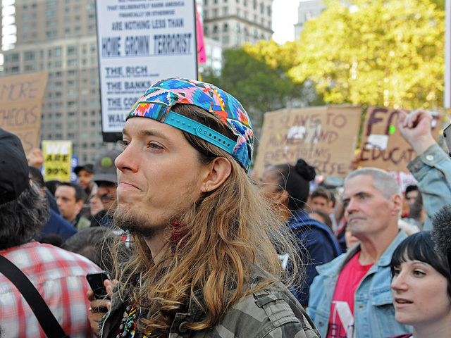 An Occupy Wall Street Protester listens to the speakers at Foley Square.