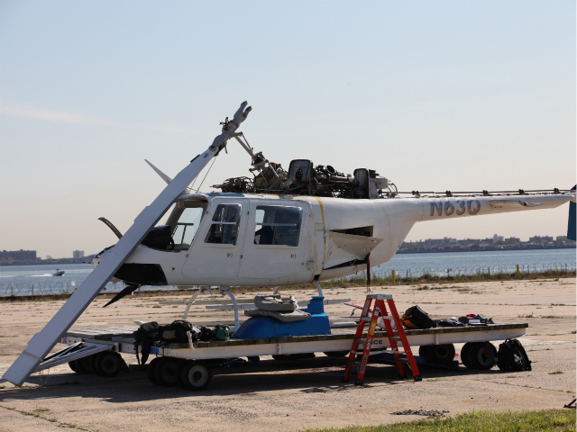 The helicopter involved in the crash was moved to Floyd Bennett Field in Brooklyn.