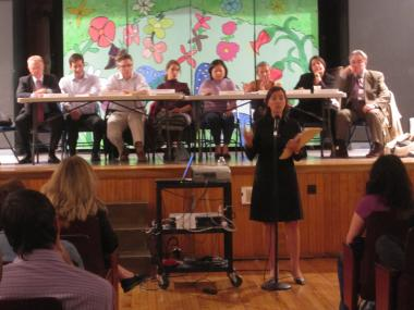 The Department of Education's Elizabeth Rose addresses parents at a hearing at P.S. 158 on proposed rezoning changes for Upper East Side elementary schools in October 2011. She returned to the school on Jan. 25, 2012 to talk to parents again about that school's future.